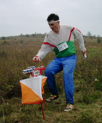 An orienteer approaches a control point.