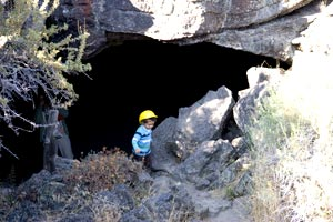 Toddler at the Entrance to Valentine Cave - Lava Beds National Monument